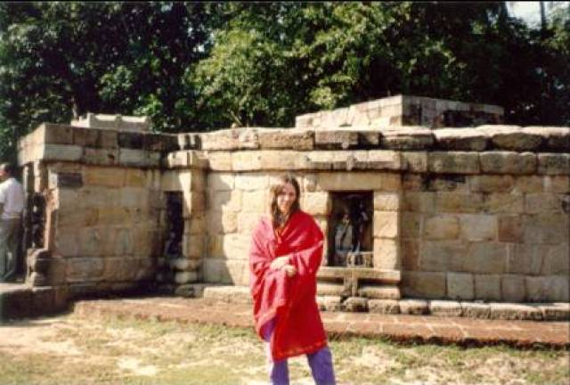 Shivagami, who practiced Bhairavi Kriya, in front of the 64 Yogini temple, Hiripur, 1990
