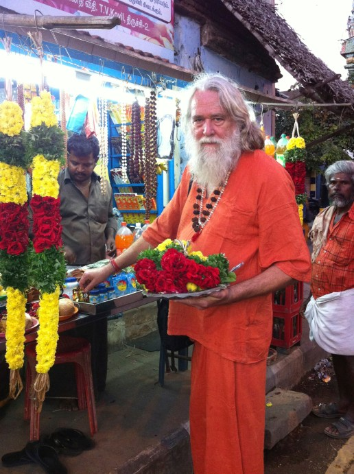 Obtaining flowers for puja at Trichy Water Shiva Temple.