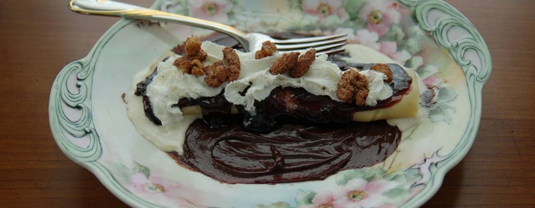 crepe with blackberry cinnz jam and whipped cream