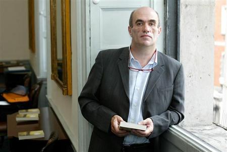 Irish author Colm Toibin poses for photographers after he won the world's richest literary prize for..