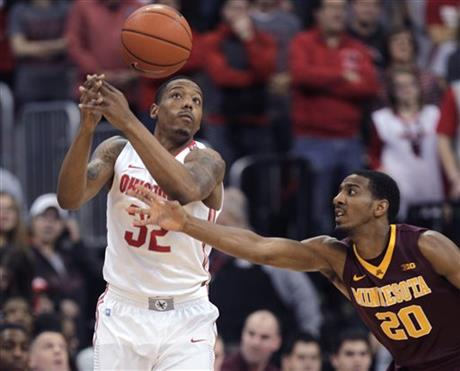 Minnesota's Austin Hollins, right, tips the ball away from Ohio State's Lenzelle Smith