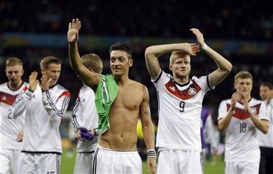 Germany's Mesut Ozil, left, and teammate Andre Schuerrle (9)