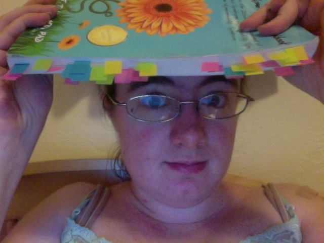 Me being silly, showing off my new book on EDS by placing it on my head.