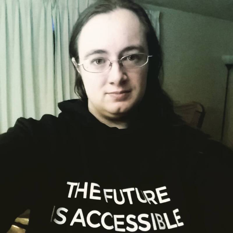 """A picture of myself, wearing a black sweatshirt that declares, """"The future is accessible."""""""