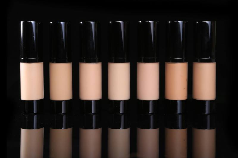 A row of bottles of foundation in seven different shades, but all for people with white skin.