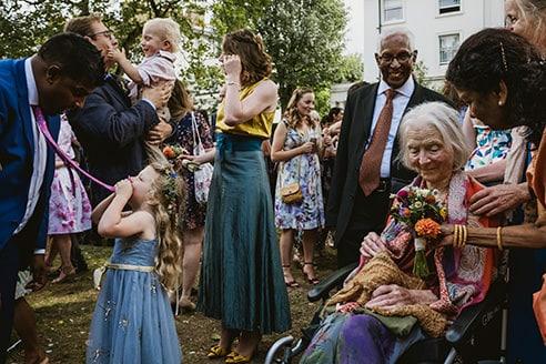 Cecil Sharp House Wedding Photography London guests enjoying the wedding