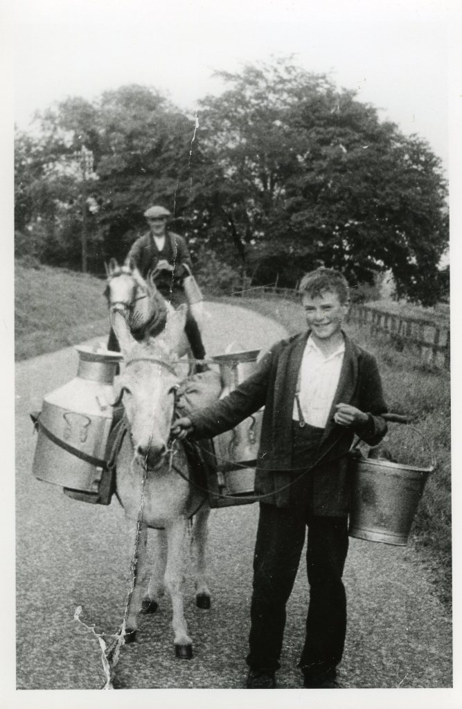 Matt Heseltine aged 11 and his father carrying milk to Hogra Farm. Ann Holubecki collection