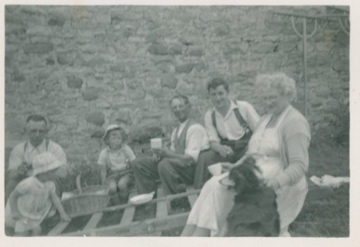 Hay timing at Thoralby c.1955. From left to right: Matthew Heseltine (Edith's father); Edith Heseltine;John Heseltine (Edith's brother); John Dinsdale (local farm labourer); Irish Worker; Rose Webster (Edith's maternal grandmother). Courtesy of Edith Pratt
