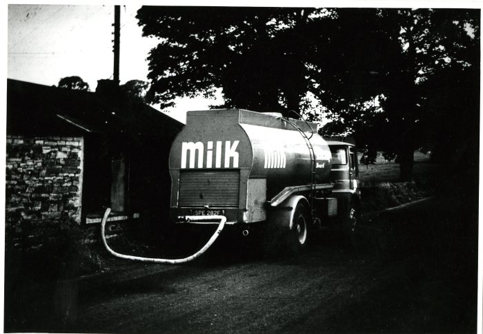 Milk tanker collecting milk from a farm. Unknown date. YDNPA