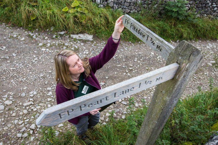 Rebecca Carpenter, one of our Dales Volunteers, surveying rights of way