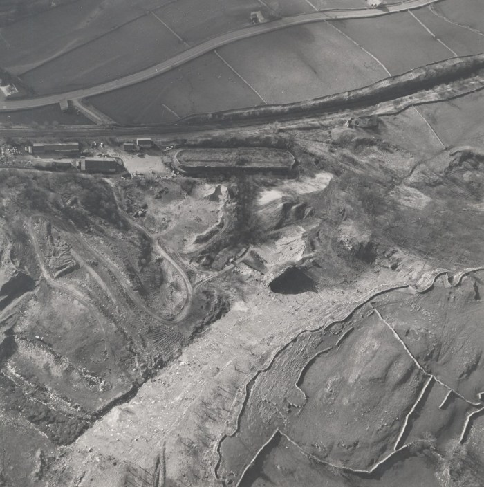 Image shows an aerial view of the limeworks site. The Hoffmann kiln is visible in the centre just below the old railway sidings