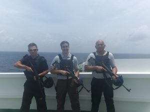 Lewis King (centre) works in private security in the Indian Ocean
