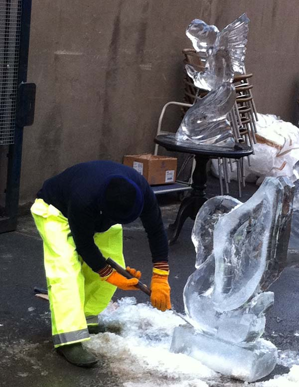 man making ice sculptures