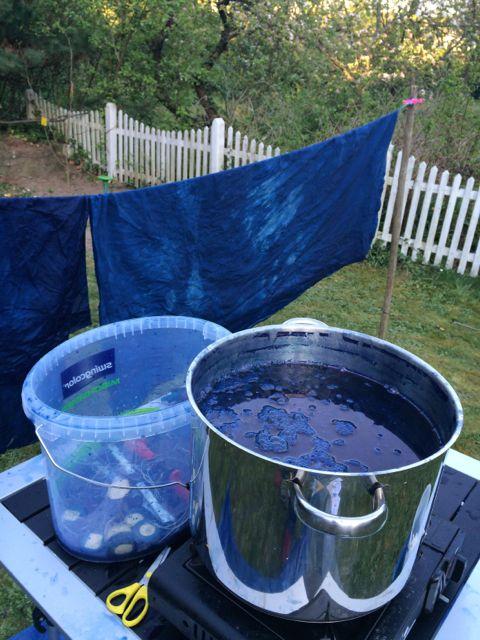 Indigo dye vat on gas camping stove in the garden.