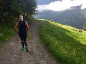 Runninggirl downhill mountain
