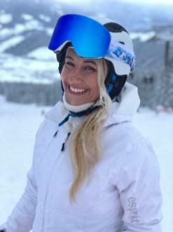 happy girl on skis blonde