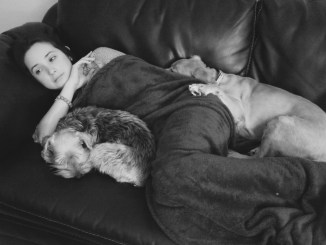 Nena with Doggies on Couch