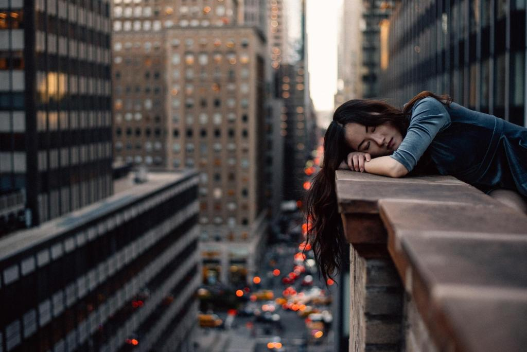 Woman Sleeping on balcony boost your mood younfolded blog