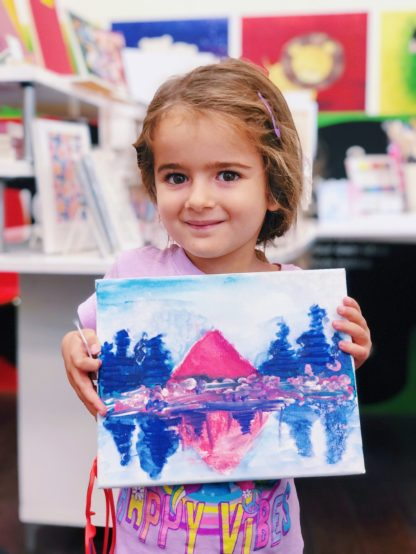 student showing art scenery
