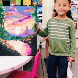 student showing scenery art