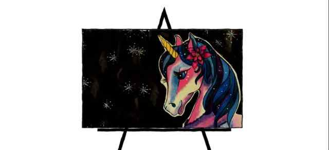 colorful unicorn drawing on easel