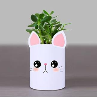 image of cat planter with plant inside