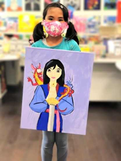 girl holding painting of Mulan on canvas