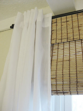 Make Your Picture Windows Look Huge By Hanging Bamboo Blinds And