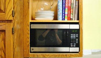 Stacking microwave and toaster oven