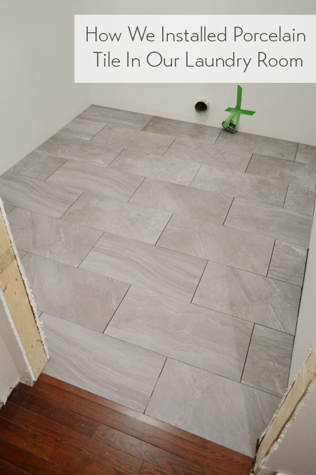 laying porcelain tile in the laundry
