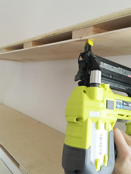 A Ryobi power nailer to attach thin plywood sheet to bottom of do it yourself floating shelves