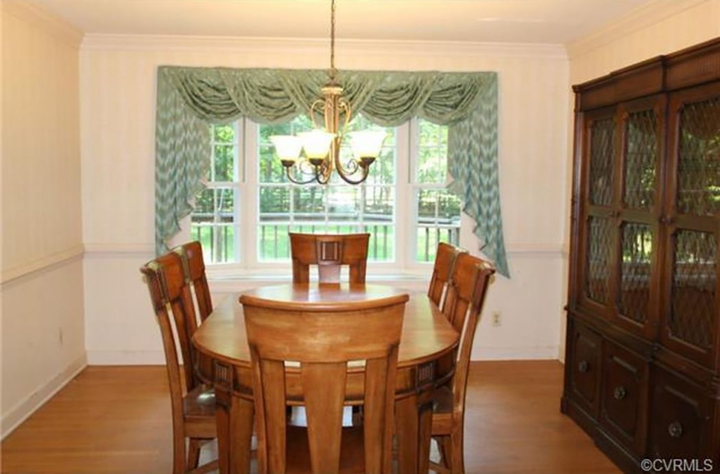 before photo of dining room with old curtain and large china cabinet