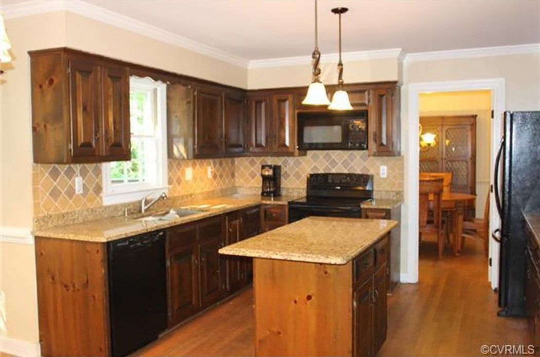before photo of kitchen with brown cabinets and tan backsplash