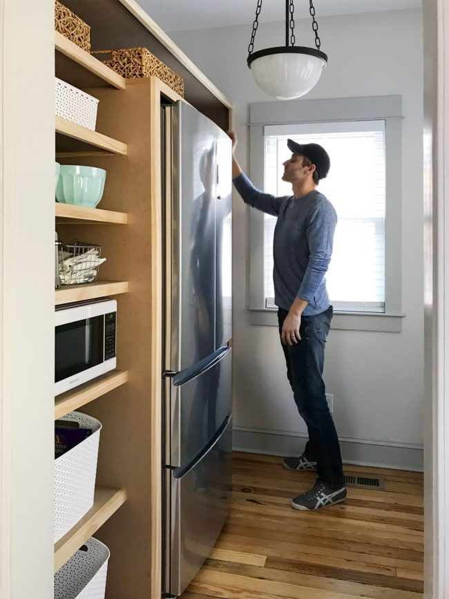 DIY pantry shelves built around a refrigerator