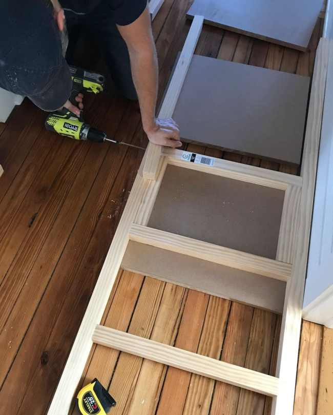 screwing 2x2 wood pieces together to create bunk bed ladder