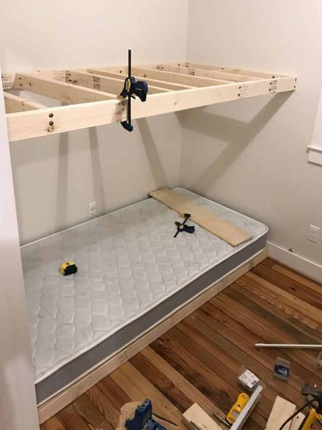 top floating bunk added in wall to wall bunk beds