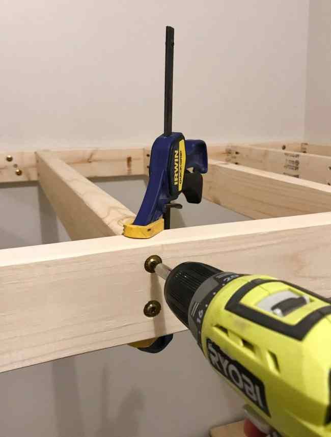 using clamps to drill top bunk supports into place