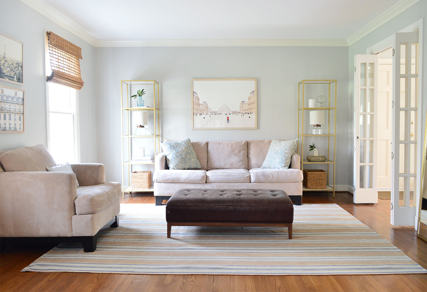 neutral living room staged to sell with some seating removed and simplified accessories