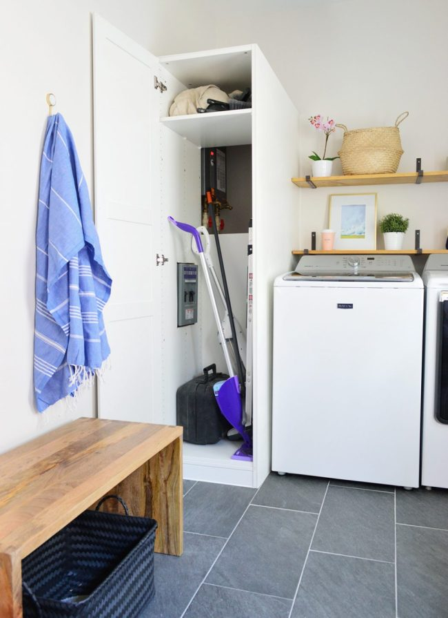 ikea pax wardrobe used for laundry storage cabinet open with access to water heater