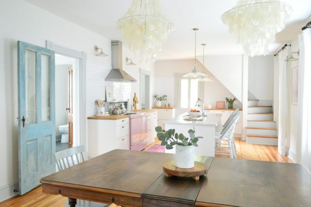 Beach house kitchen and dining room with faux greenery on table top