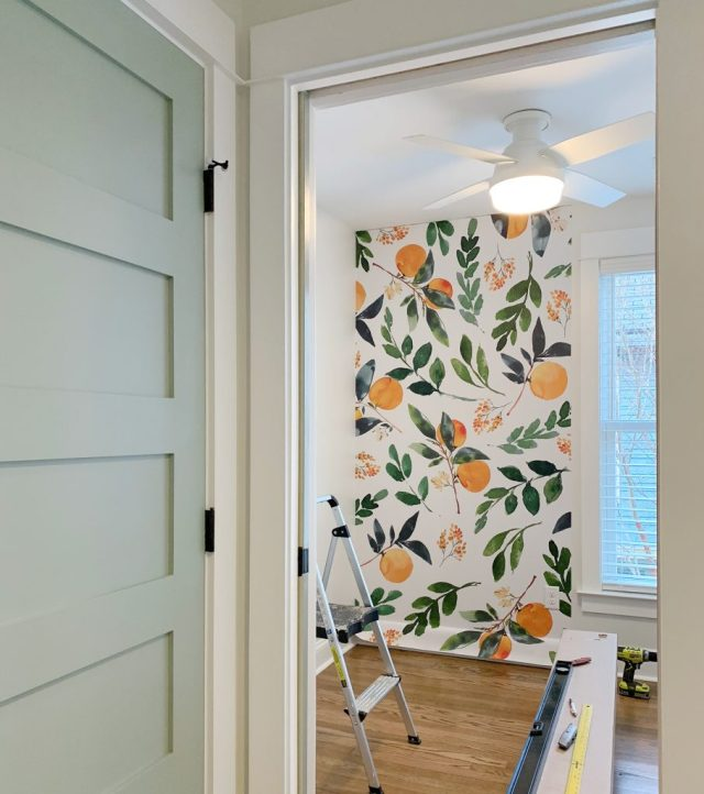 Removable Orange Blossom Wallpaper Installation With Blue Painted Door