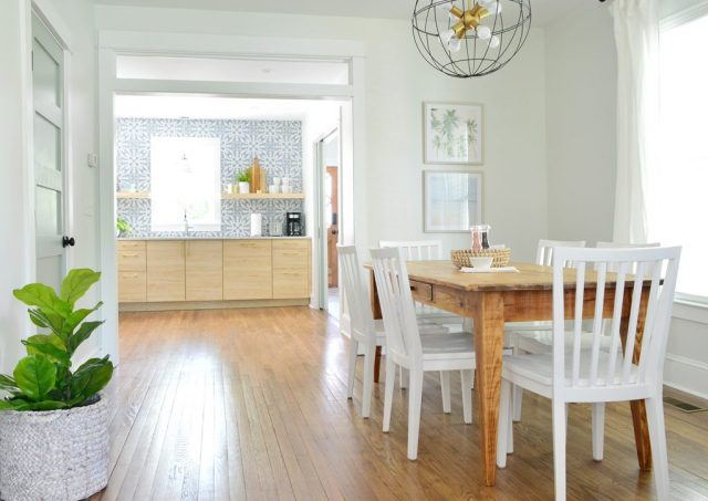 Duplex Dining Room With Blue And Wood Kitchen In Background