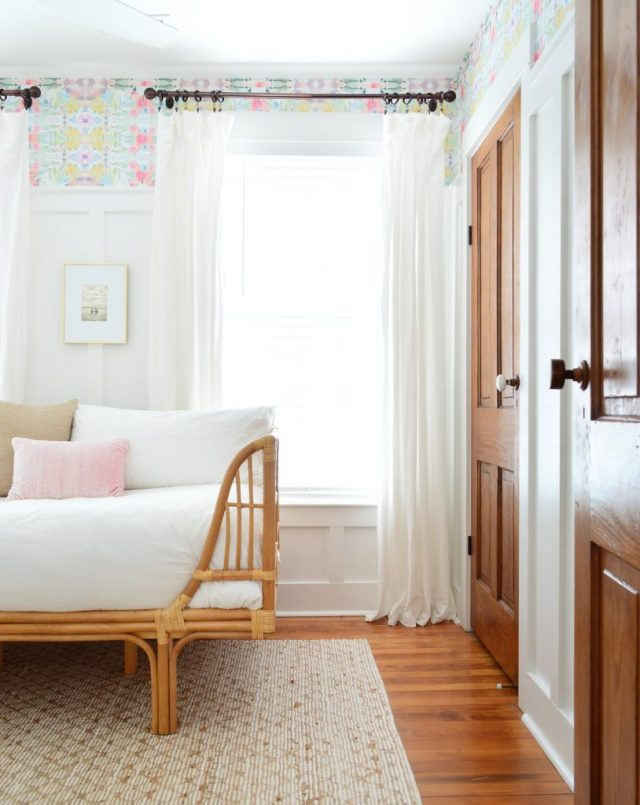 Bedroom With Wood Doors And Peel And Stick Wallpaper With Rattan Daybed
