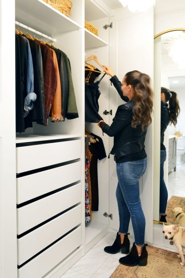 Sherry Getting Clothes Off Hanging Bar In Ikea Pax Closet