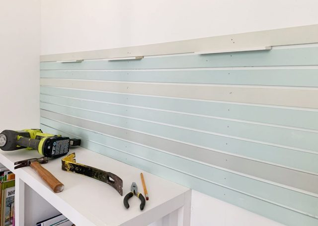 First Section Of Painted Wood Lattice Strips Attached To Wall Using Spacers