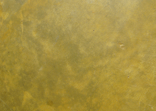 close-up detail of stained concrete floor in Tuscan Gold color by Behr Semi-Transparent Concrete Stain