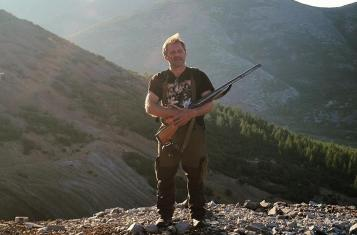 A bear hunter with his gun in Magadan, Russia