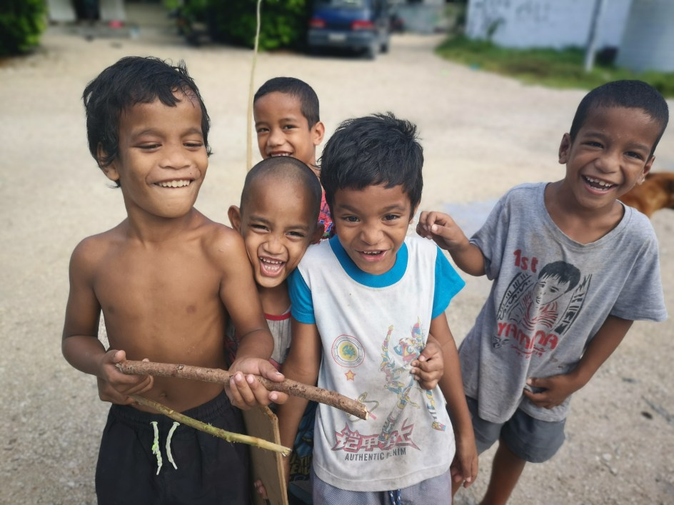 Some laughing kids in Nauru as part of a Mega Tour of the Least Visited Countries in the world