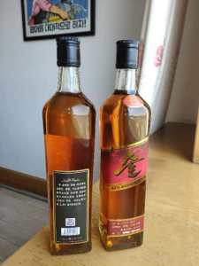 North Korea's new 'Samilpo' whiskey -- black label on the left and red label on the right.