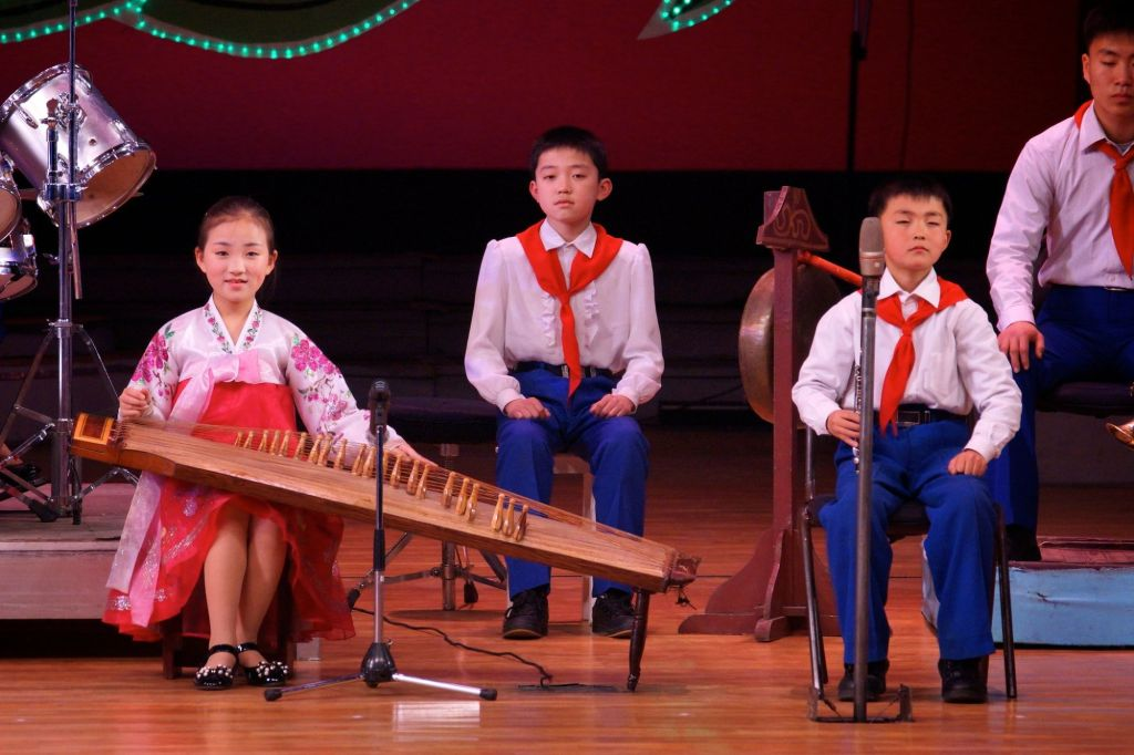 Children playing Kayagum, a traditional Korean instruments